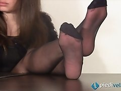 Sultry Italian babe puts her feet up on the desk to tease them