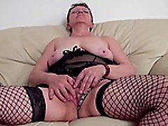Slutty grandmother called Janet still passionately plays with her cunt