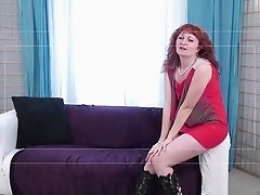 Gorgeous granny with long red hair sucking a stranger's cock