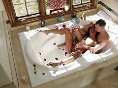 Beautiful exotic girl having fun with her partner in the bathroom
