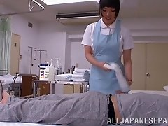 Salacious Japanese nurse gives a blowjob to a patient