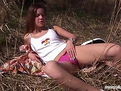 Stimulating babe gets horny during her walk in the grasslands and masturbates thoroughly to absolute orgasm
