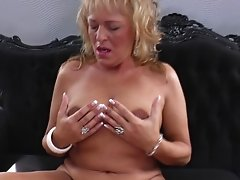 Grown blonde with saggy tits indulges in a barbaric solo finger job in pov
