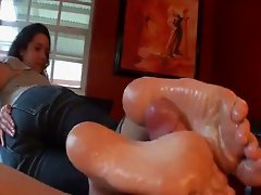 Indoor oily footjob for POV