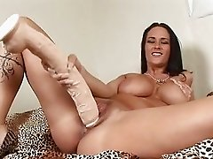Heavy chested brunette sticks monster dildo up her shaved taco